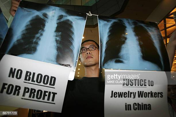 Several workers groups and workers from Asia including Taiwan, India, Cambodia and Thailand take part in a campaign outside the Jewellery and Watch...
