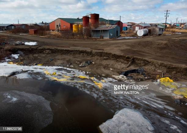 Severe erosion of the permafrost tundra threatens a school at the climate change affected Yupik Eskimo village of Napakiak on the Yukon Delta in...