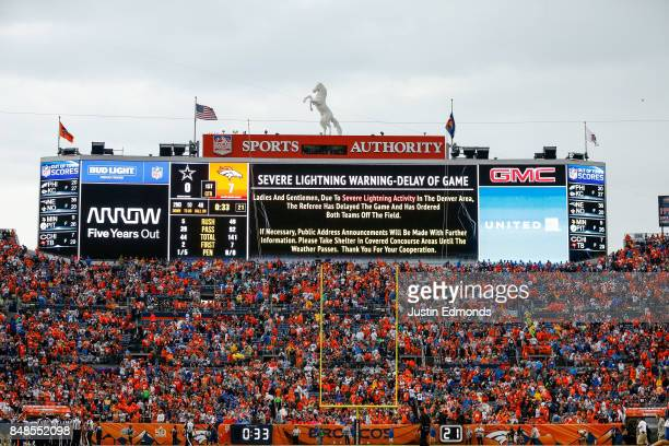 A severe lightning warning is shown on the jumbotron during the second quarter of a game between the Denver Broncos and the Dallas Cowboys at Sports...