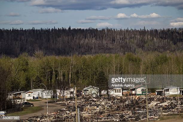 A severely destroyed neighborhood is seen during a wildfire that erupted outside Fort McMurray Alberta Canada on May 11 2016 Wildfire erupted on 3...