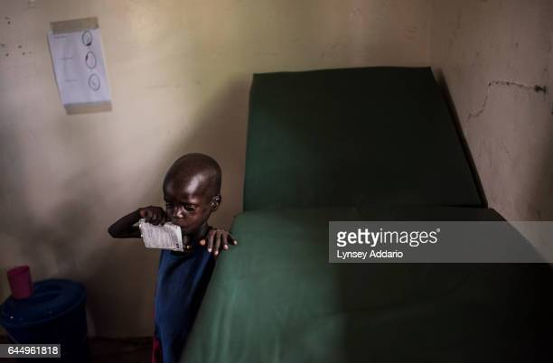 A severely malnourished boy eats a nutrient and calorierich packet of food while being treated by medical staff from Doctors without Borders at the...