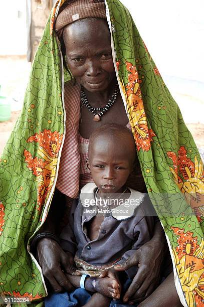 A severely malnourished child is tended to by his grandmother at the Medecinssansfrontieres clinic December 4 2003 in Maradi Niger Chronic...