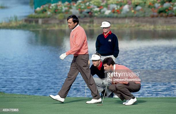Severiano Ballesteros and Jose Maria Olazabal of the European team lining up a putt in their match against Davis Love III and Tom Kite of the United...