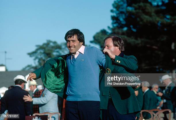 Severiano Ballesteros of Spain is presented with the Green Jacket by the previous year's winner, Craig Stadler, after winning the US Masters Golf...