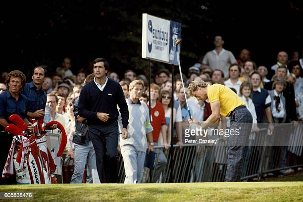Severiano Ballesteros of Spain watches Bernhard Langer of Germany on the 17th tee during the Suntory World Match Play Championship on the West Course...