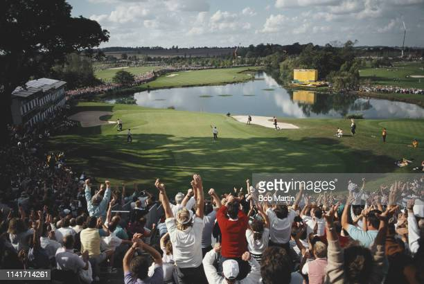 Severiano Ballesteros of Spain with arms aloft celebrates on the 18th green with the crowd after Europe tied the 28th Ryder Cup Matches 14 to14...