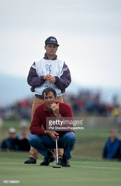 Severiano Ballesteros of Spain with his caddie Billy Foster during the British Open Golf Championship on the Aisla course at Turnberry Golf Club in...