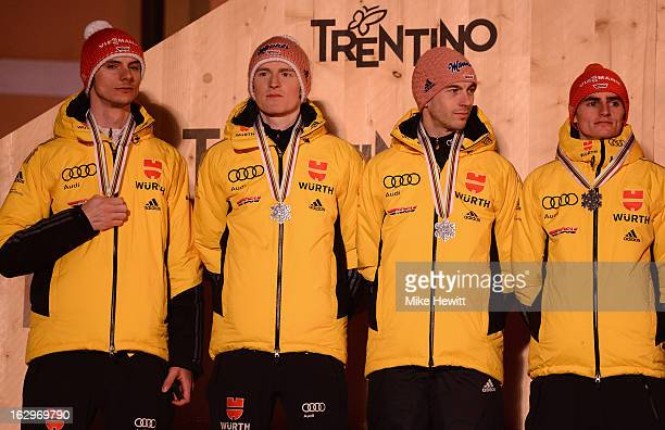 Severin Freund Michael Neumayer Richard Freitag and Andreas Wank of Germany pose with their Silver medals at the medal ceremony for the Men's Ski...
