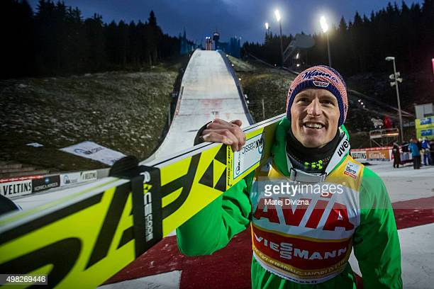 Severin Freund of Germany carries his ski as he celebrates his third place after the individual competition at the FIS World Cup Ski Jumping day...