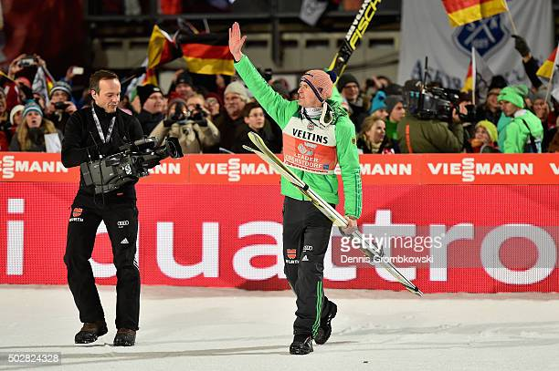 Severin Freund of Germany celebrates after his final competition jump on Day 2 of the 64th Four Hills Tournament event on December 29 2015 in...
