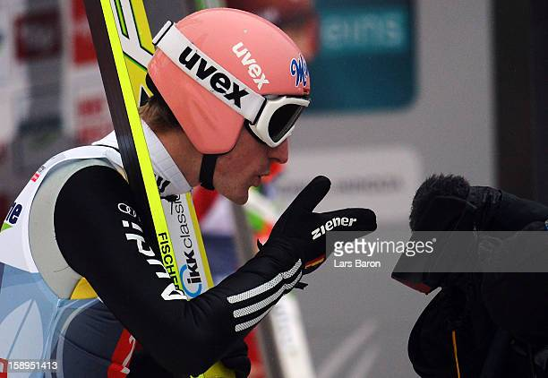 Severin Freund of Germany celebrates after the final round for the FIS Ski Jumping World Cup event of the 61st Four Hills ski jumping tournament at...