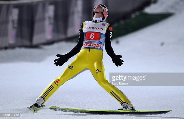 Severin Freund of Germany celebrates during the final round second leg for the FIS Ski Jumping World Cup event at the 61st Four Hills ski jumping...