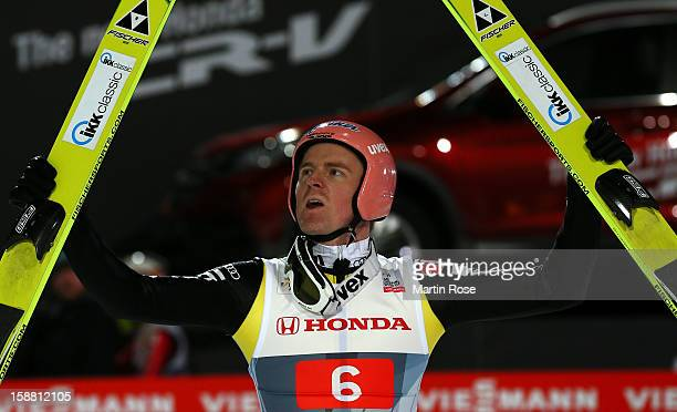 Severin Freund of Germany celebrates during the final round second leg for the FIS Ski Jumping World Cup event of the 61st Four Hills ski jumping...