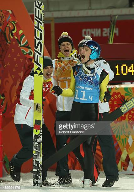 Severin Freund of Germany celebrates with his team mates Andreas Wellinger Marinus Kraus and Andreas Wank after they won the gold medal in the Ski...