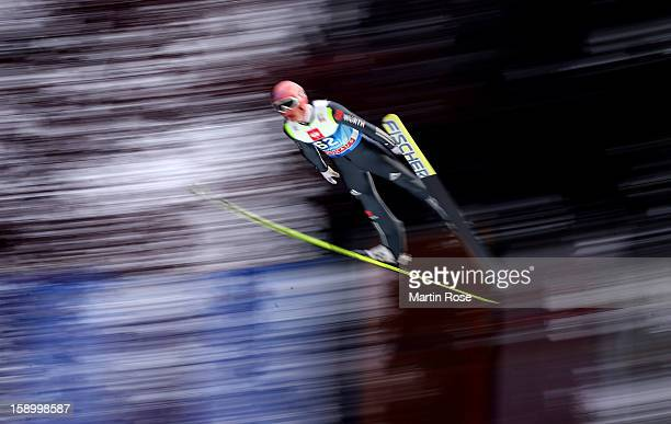 Severin Freund of Germany competes during the final round for the FIS Ski Jumping World Cup event of the 61st Four Hills ski jumping tournament at...