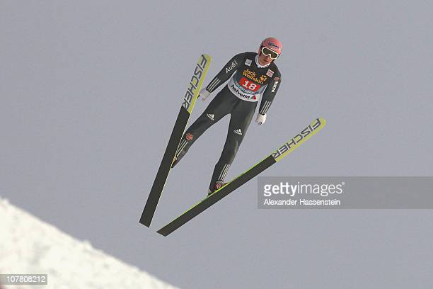 Severin Freund of Germany competes during the first round for the FIS Ski Jumping World Cup event at the 59th Four Hills ski jumping tournament at...