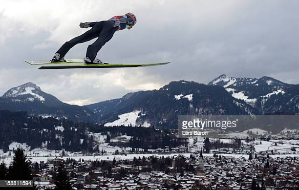 Severin Freund of Germany competes during the trail round for the FIS Ski Jumping World Cup event at the 61st Four Hills ski jumping tournament at...