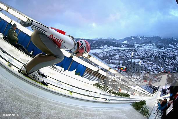 Severin Freund of Germany competes on day 1 of the Four Hills Tournament Ski Jumping event at SchattenbergSchanze Erdinger Arena on December 27 2014...
