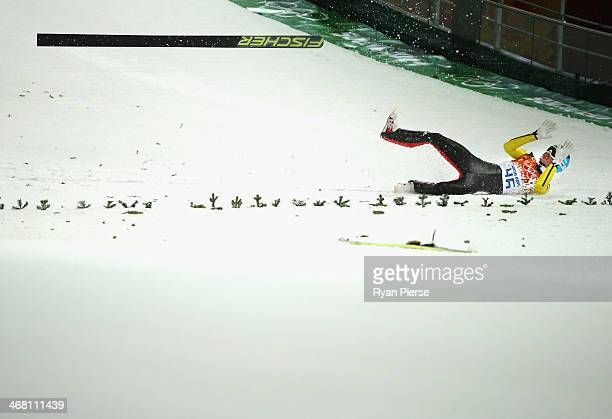 Severin Freund of Germany crashes during the Men's Normal Hill Individual Ski Jumping Final on day 2 of the Sochi 2014 Winter Olympics at RusSki...