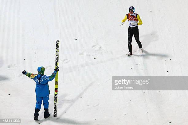 Severin Freund of Germany crashes upon landing during the Men's Normal Hill Individual first round on day 2 of the Sochi 2014 Winter Olympics at the...