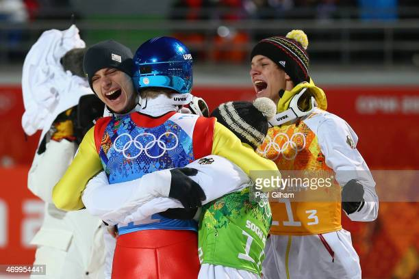 Severin Freund of Germany is mobbed by teammates after the Men's Team Ski Jumping final round on day 10 of the Sochi 2014 Winter Olympics at the...