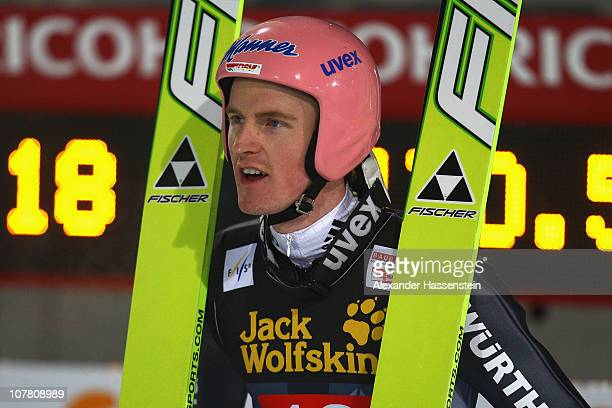 Severin Freund of Germany looks on after the final round for the FIS Ski Jumping World Cup event at the 59th Four Hills ski jumping tournament at...