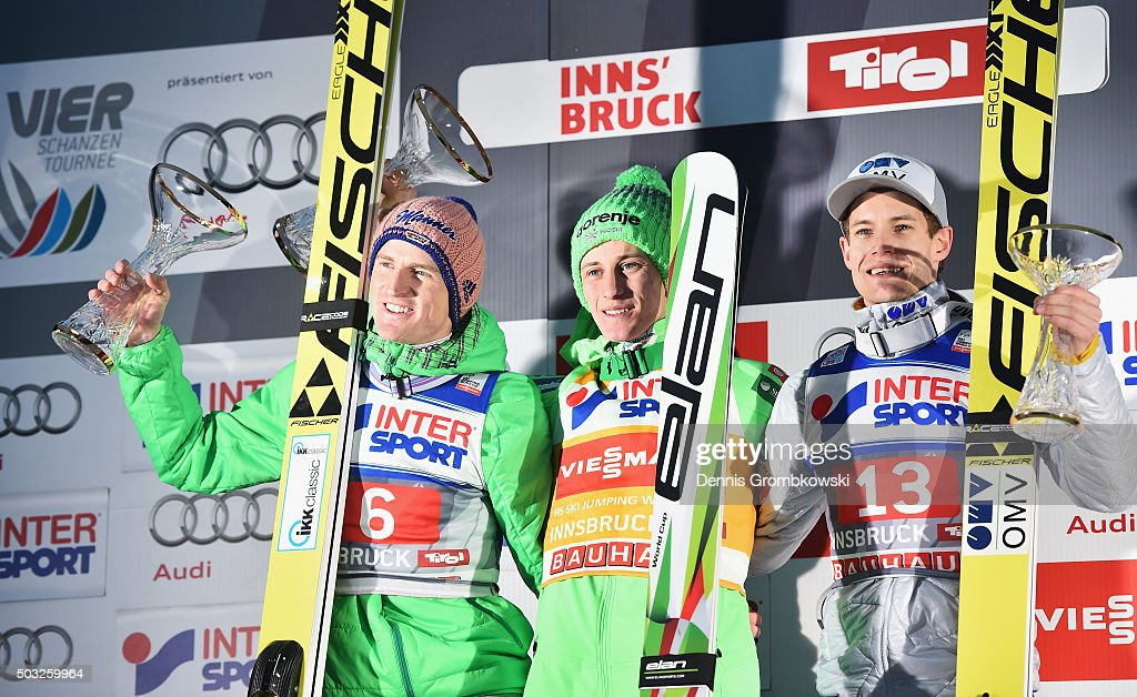 Severin Freund of Germany, Peter Prevc of Slovenia and Kenneth Gangnes of Norway celebrate on the podium after Day 2 of the Innsbruck 64th Four Hills Tournament ski jumping event on January 3, 2016 in Innsbruck, Austria.