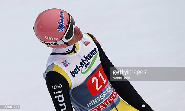 Severin Freund of Germany reacts during the final round for the FIS Ski Jumping World Cup event of the 61st Four Hills ski jumping tournament at...