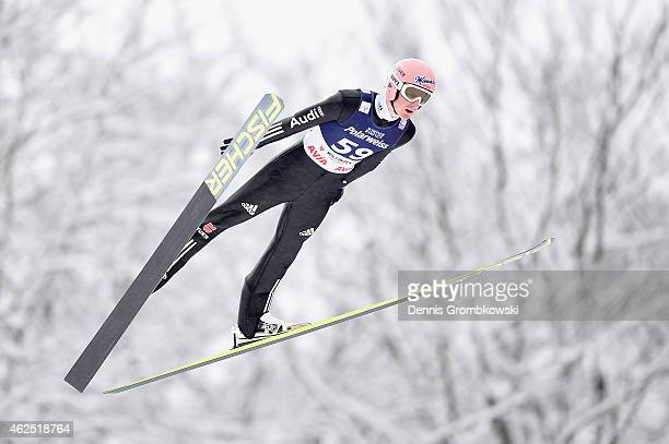 Severin Freund of Germany soars through the air during his first training jump on Day One of the FIS Ski Jumping World Cup on January 30 2015 in...