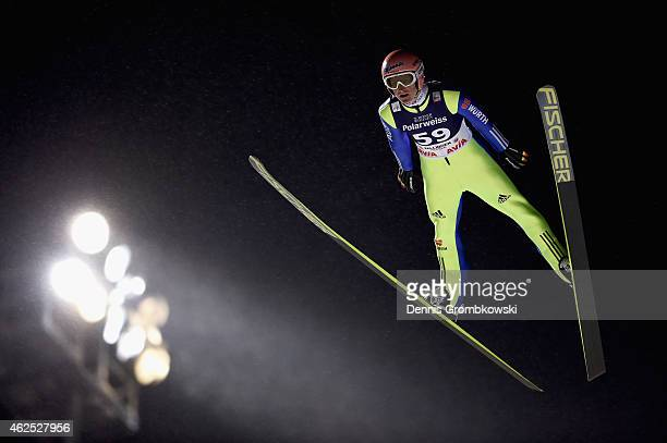 Severin Freund of Germany soars through the air during his first round jump on Day One of the FIS Ski Jumping World Cup on January 30 2015 in...