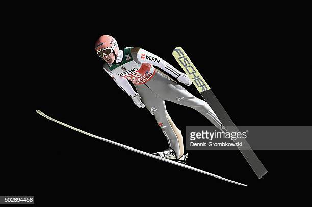 Severin Freund of Germany soars through the air during his qualification jump on Day 1 of the 64th Four Hills Tournament ski jumping event on...