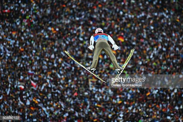 Severin Freund of Germany soars through the air during his competition jump on Day 2 of the 64th Four Hills Tournament ski jumping event on January 1...
