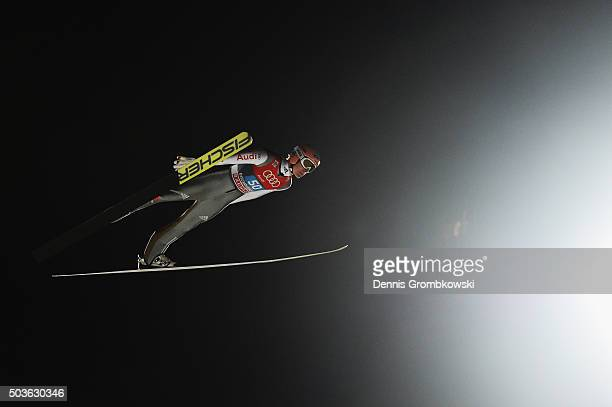 Severin Freund of Germany soars through the air during his competition jump on Day 2 of the Bischofshofen 64th Four Hills Tournament ski jumping...