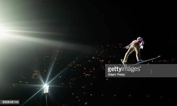 Severin Freund of Germany soars through the air during his qualification jump on Day 1 of the 65th Four Hills Tournament ski jumping event on...
