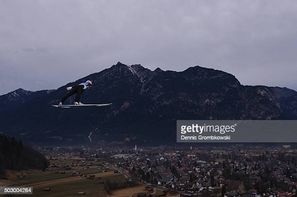 Severin Freund of Germany soars through the air during his training jump on Day 1 of the 64th Four Hills Tournament ski jumping event on December 31...