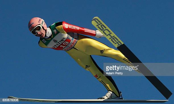 Severin Freund of Germany soars through the air during his training jump on Day 2 of the 65th Four Hills Tournament ski jumping event on December 30...
