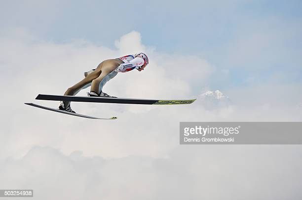 Severin Freund of Germany soars through the air during his trial jump on Day 2 of the Innsbruck 64th Four Hills Tournament ski jumping event on...