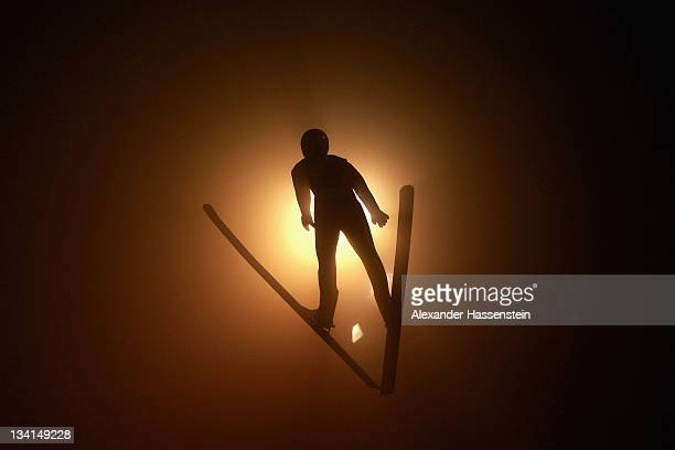 Severin Freund of Germany soars through the air during the large hill individual ski jumping event at the FIS World Cup Nordic Opening 2011 on...