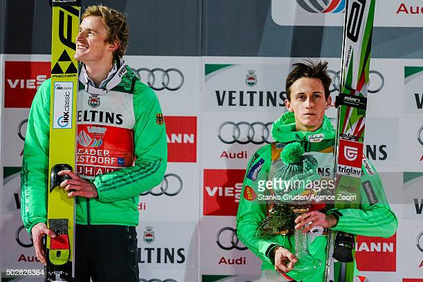 Severin Freund of Germany takes 1st place Peter Prevc of Slovenia takes 3rd place during the FIS Nordic World Cup Four Hills Tournament on December...