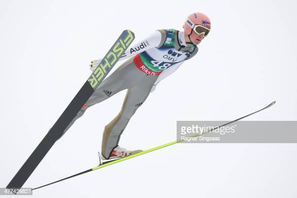 Severin Freund of Germany takes first place during the FIS Ski Jumping World Cup Men's HS134 on March 9 2014 in Oslo Norway