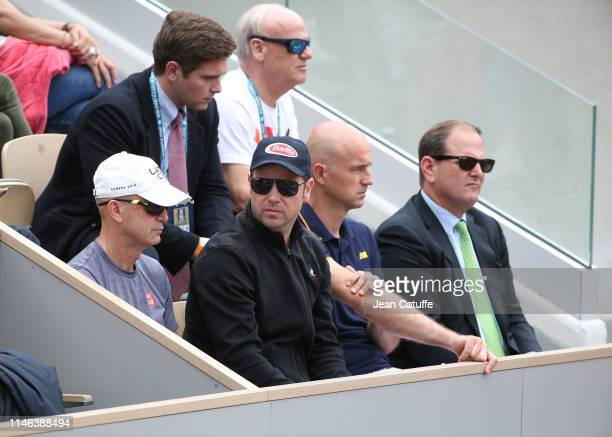 Severin Luthi and Ivan Ljubicic, Roger Federer's coaches, Tony Godsick his agent attend his match on day 1 of the 2019 French Open at Roland Garros...
