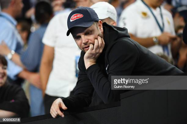 Severin Luthi coach of Roger Federer of Switzerland looks on in Federer's quarterfinal match against Tomas Berdych of the Czech Republic on day 10 of...