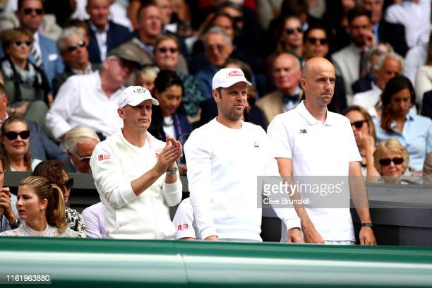 Severin Luthi, trainer and Ivan Ljubicic, coach of Roger Federer look on in the Men's Singles final between Roger Federer of Switzerland and Novak...