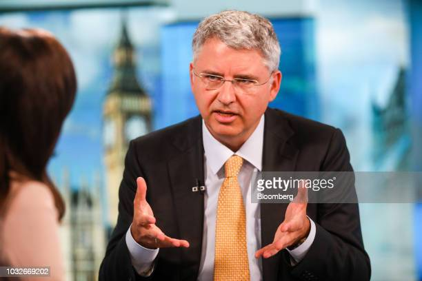 Severin Schwan chief executive officer of Roche Holding AG gestures while speaking during a Bloomberg Television interview in London UK on Thursday...