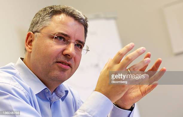 Severin Schwan chief executive officer of Roche Holding AG gestures during an interview at the company's headquarters in Basel Switzerland on...