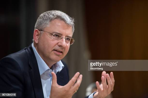 Severin Schwan chief executive officer Roche Holding AG gestures as he speaks during an interview in London UK on Wednesday Dec 6 2017 Roche's new...