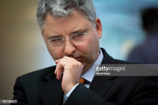 Severin Schwan chief executive officer Roche Holding AG listens during an interview in New York US on Thursday Sept 19 2013 Roche Holding AG isn't...