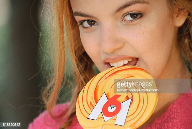 Severine Ferrer is the host of the television shows Hit Dance and Fan de on channel M6 in France She is eating a yellow lollipop decorated with the...