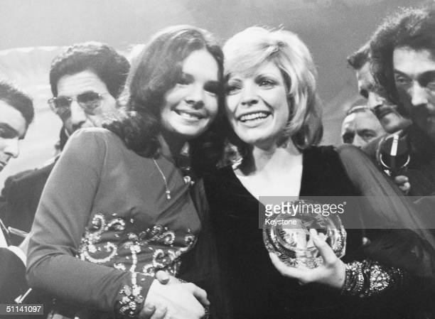 Severine of Monaco celebrates her win at the Eurovision Song Contest held in Dublin, 3rd April 1971. With her is the previous year's winner,...