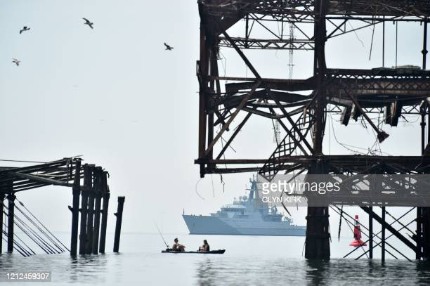 Severn, an offshore patrol vessel of the British Royal Navy, is anchored off the West Pier in Brighton on May 8 as the nation celebrates the 75th...